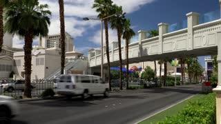 LAS VEGAS - Circa April, 2017 - A large format 4K daytime establishing shot of traffic passing by Caesars Palace on the Las Vegas Strip.