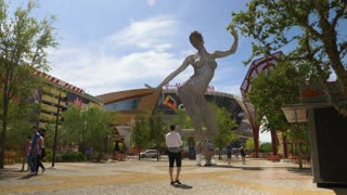 LAS VEGAS - Circa April, 2017 - Tourists visit the Bliss Dance sculpture outside of T-Mobile Arena in Las Vegas.