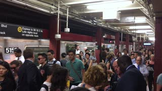 NEW YORK - Circa June, 2017 - A high angle view of the busy 34th Manhattan subway platform at rush hour.