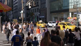 NEW YORK CITY - Circa June, 2017 - A slow motion shot of pedestrians crossing West 42nd Street in midtown Manhattan. Shot at 48fps.