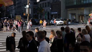 NEW YORK CITY - Circa June, 2017 - An extreme slow motion shot of pedestrians crossing West 42nd Street in midtown Manhattan. Shot at 180fps. Part 1 of 2.