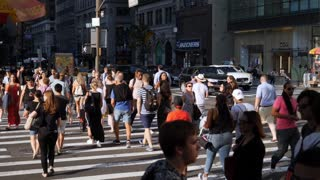 NEW YORK CITY - Circa June, 2017 - An extreme slow motion shot of pedestrians crossing West 42nd Street in midtown Manhattan. Shot at 180fps. Part 2 of 2.