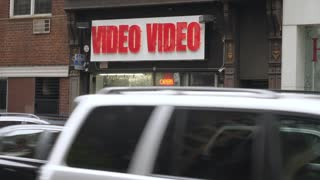 NEW YORK CITY - Circa October, 2017 - A daytime establishing shot of a video store in Manhattan. Day/Night matching available.