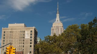 NEW YORK CITY - Circa October, 2017 - A daytime fall exterior establishing shot (DX) of the skyline of Manhattan with the top of the Empire State Building above the treeline of Madison Square Park.