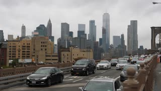 NEW YORK CITY - Circa October, 2017 - A daytime overcast establishing shot of traffic on the Brooklyn Bridge on the Brooklyn side. Lower Manhattan and the Freedom Tower is in the distance.