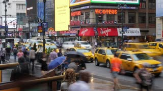 NEW YORK CITY - Circa October, 2017 - A fast time lapse view and traffic and pedestrians on a rainy day outside of Manhattan's Penn Station.