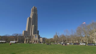 PITTSBURGH - Circa April, 2017 - A daytime establishing shot of the Cathedral of Learning on Pitt's campus on a sunny early Spring day.