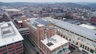 PITTSBURGH - Circa December, 2017 - A winter overcast reverse aerial establishing shot of the Bakery Square neighborhood in Pittsburgh's East End, home to Google offices.