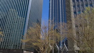 PITTSBURGH, PA - Circa April, 2017 - A wide tilt up establishing shot of tall buildings in downtown Pittsburgh on a sunny Spring day.