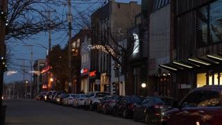 PITTSBURGH, PA - Circa December, 2017 - A nighttime establishing shot of the upscale storefronts along Walnut Street in Pittsburgh's Shadyside neighborhood.