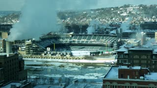 PITTSBURGH, PA - Circa January 2018 - A day time lapse wintery high angle establishing shot of PNC Park on Pittsburgh's North Shore, home to the Pirates. Ice flows on the frozen Allegheny River.