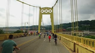 PITTSBURGH, PA - Circa May, 2017 - Bikers, walkers, pedestrians, and exercise enthusiasts on the 10th Street Bridge during Open Streets Pittsburgh on Memorial Day Weekend, 2017.