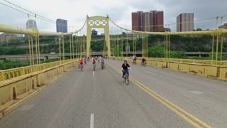 PITTSBURGH, PA - Circa May, 2017 - Bikers, walkers, pedestrians, and exercise enthusiasts participate in Open Streets Pittsburgh on the 10th Street Bridge on Memorial Day Weekend, 2017. Reverse view, part 1 of 2.