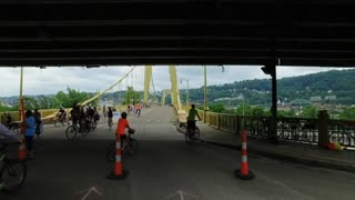 PITTSBURGH, PA - Circa May, 2017 - Bikers, walkers, pedestrians, and exercise enthusiasts participate in Open Streets Pittsburgh on the 10th Street Bridge on Memorial Day Weekend, 2017.