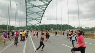 PITTSBURGH, PA - Circa May, 2017 - Bikers, walkers, pedestrians, and exercise enthusiasts participate in Open Streets Pittsburgh on the Birmingham Bridge on Memorial Day Weekend, 2017. Part 2 of 3.