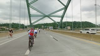PITTSBURGH, PA - Circa May, 2017 - Bikers, walkers, pedestrians, and exercise enthusiasts participate in Open Streets Pittsburgh on the Birmingham Bridge on Memorial Day Weekend, 2017. Part 3 of 3.