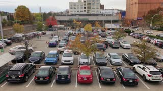 PITTSBURGH, PA - Circa November, 2017 - A high angle establishing shot of the parking lot outside a Whole Foods Market in Pittsburgh's East Liberty neighborhood.