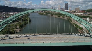 PITTSBURGH, PA - Circa September, 2017 - A high angle aerial profile right to left establishing shot of traffic passing on the Birmingham Bridge over the Monongahela River.