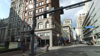 PITTSBURGH, PA - Circa September, 2017 - A three-quarter forward driving perspective past the businesses and storefronts in downtown Pittsburgh.