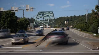 PITTSBURGH, PA - Circa September, 2017 - A time lapse establishing shot of traffic entering and exiting the Birmingham Bridge on Pittsburgh's South Side.