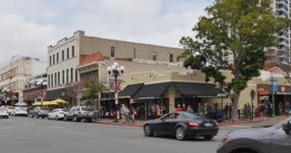 SAN DIEGO, CA - Circa February, 2017 - A daylight establishing shot of corner bars and restaurants in San Diego's Gaslamp Quarter.
