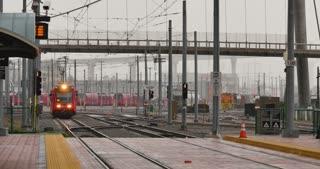SAN DIEGO, CA - Circa February, 2017 - A daytime establishing shot of a San Diego Metropolitan Transit System train car approaching the Gaslamp Quarter Station.
