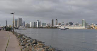 SAN DIEGO, CA - Circa February, 2017 - A daytime overcast establishing shot of the San Diego skyline as seen from Coronado Island.