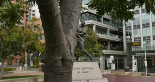 SAN DIEGO, CA - Circa February, 2017 - A dolly establishing shot of the Tony Gwynn Statue near Petco Park baseball field.
