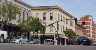 SAN DIEGO, CA - Circa February, 2017 - A low angle daytime establishing shot of traffic in San Diego's Gaslamp Quarter.