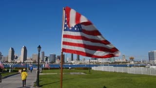 SAN DIEGO, CA - Circa February, 2017 - American flags flap in the breeze at Centennial Park on Coronado Island.