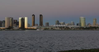 SAN DIEGO, CA - Circa February, 2017 - An evening establishing shot of the San Diego skyline with the San Diego Convention Center in the foreground.