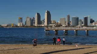 SAN DIEGO, CA - Circa February, 2017 - People on a beach on Coronado Island view the San Diego skyline on a sunny day.