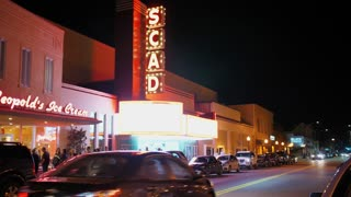 SAVANNAH, GA - Circa February, 2018 - A night establishing shot of the SCAD Theatre on East Broughton Street in downtown Savannah, Georgia - Landmark local playhouse with iconic marquee presenting classic films & live concerts since 1946.