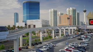The Las Vegas Monorail passes by the Convention Center with hotels and casinos in the background.