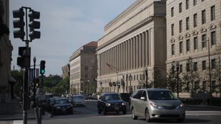 WASHINGTON, D.C. - Circa August, 2017 - A daytime side profile wide establishing shot of the Department of Commerce Building in DC.