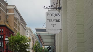WASHINGTON, D.C. - Circa August, 2017 - A daytime summer establishing shot of the Ford's Theater sign in DC.
