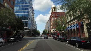 WASHINGTON, D.C. - Circa August, 2017 - A forward perspective driving on a downtown Washington DC business district street.