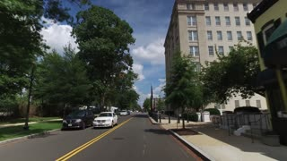 WASHINGTON, D.C. - Circa August, 2017 - A forward perspective driving on a typical street in a business district in downtown DC.