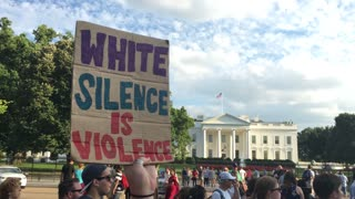 WASHINGTON, D.C. - Circa August, 2017 - A large group of protesters hold anti-hate signs outside The White House after the tragic events in Charlottesville, Virginia.