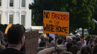 WASHINGTON, D.C. - Circa August, 2017 - A large group of protesters hold anti-hate signs outside The White House.