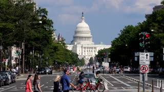 WASHINGTON, D.C. - Circa August, 2017 - A long establishing shot of the Capitol Dome on Capitol Hill as seen from Pennsylvania Avenue. Shot in 5K.