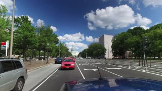 WASHINGTON, D.C. - Circa August, 2017 - A rear view perspective driving on Pennsylvania Avenue with the Capitol Building in the distance.