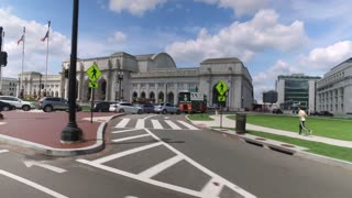 WASHINGTON, D.C. - Circa August, 2017 - A side view perspective driving past Union Station on Washington DC's Capitol Hill.