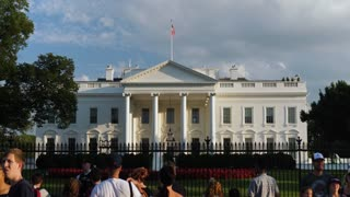 WASHINGTON, D.C. - Circa August, 2017 - An evening exterior establishing shot of the north side of the White House with tourists on Pennsylvania Avenue in the foreground.
