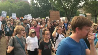 WASHINGTON, D.C. - Circa August, 2017 - Anti-Donald Trump protesters chant and march outside The White House after the tragic events in Charlottesville, Virginia.