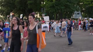 WASHINGTON, D.C. - Circa August, 2017 - Anti-hate protesters march on Pennsylvania Avenue near the Washington Monument after the tragic events in Charlottesville, Virginia.