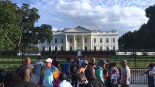 WASHINGTON, D.C. - Circa August, 2017 - Tourists on Pennsylvania Avenue visit the White House.