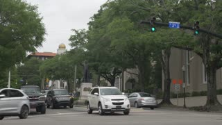 WILMINGTON, NC - Circa May, 2017 - An overcast establishing shot of traffic in downtown Wilmington, North Carolina.