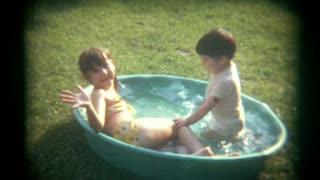 Vintage Film Kids Play in Kiddie Pool