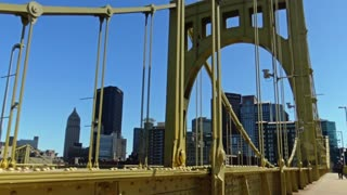 Walking over the Roberto Clemente Bridge in Pittsburgh.